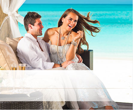 Happy Newlyweds Sitting Together During Their Weddingmoon At An All Inclusive Sandals Resort.