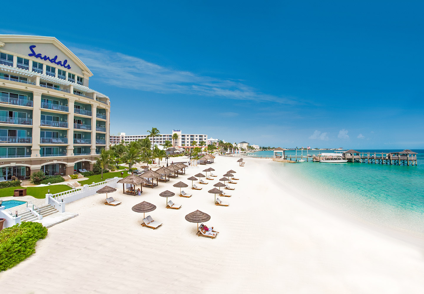 Beautiful Couples Cobannas Lining The White Sandy Beaches Outside Of The All Inclusive Sandals Royal Bahamian Resort In Nassau, Bahamas.