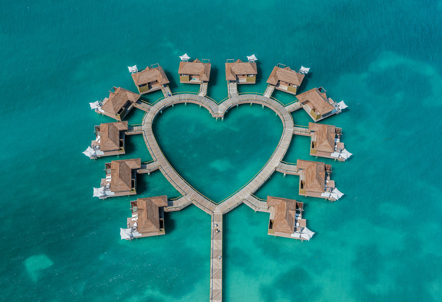 overwater bungalows in the shape of a heart in jamaica