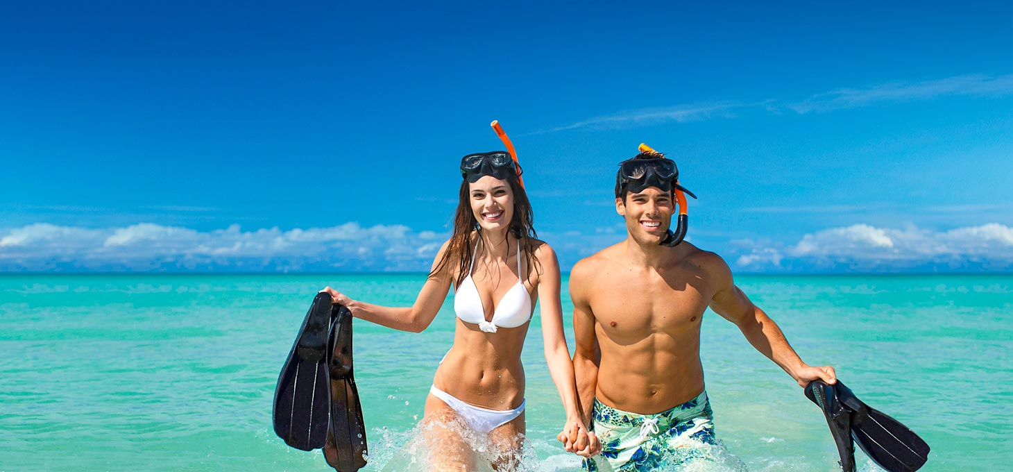 Couple with diving accessories